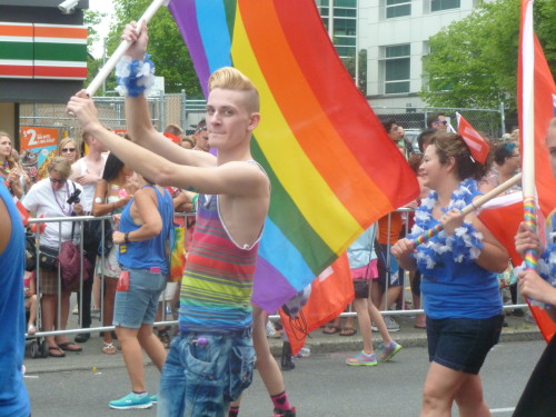 blonde rainbow flag marcher